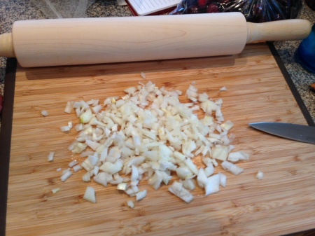 The maple rolling pin next to the more seasoned bamboo board.